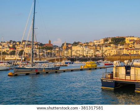 SAINT PETER PORT, BAILIWICK OF GUERNSEY - SEPTEMBER 12, 2014: View of harbor at sunrise, Channel Islands