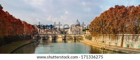 Saint Peter's basilica and Saint Angelo bridge in Rome - stock photo