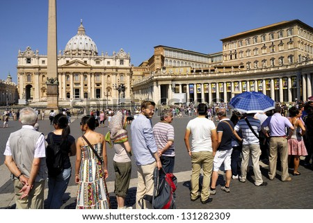 SAINT PETER'S BASILICA, ROME- JUNE 18: A large crowd of tourists and pilgrims, unidentified,waits in line to enter the Vatican Museums, June 18, 2011 in Rome, Italy. - stock photo