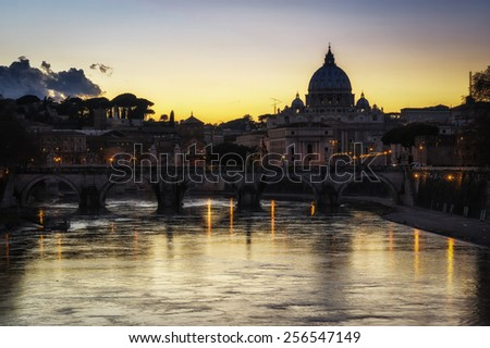 Saint Peter's Basilica view from the famous Ponte Umberto over the River Tiber near the Sant Angelo. - stock photo