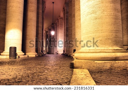 Saint Peter's colonnade at night in Vatican City - stock photo