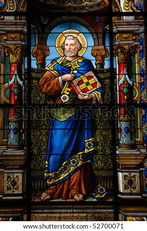 Saint Peter. Stained glass window created by F. Zettler (1878-1911) at the German Church (St. Gertrude's church) in Gamla Stan, Stockholm. - stock photo