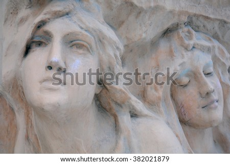 SAINT - PETERBURG, RUSSIA - JANUARY 9, 2010: Vandalized bas-relief of women faces on one of the house in Bankovskiy pereulok. - stock photo