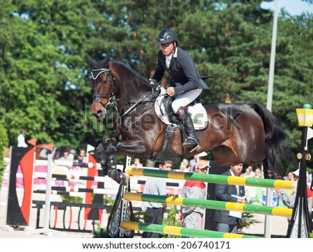 SAINT PETERSBURG-JULY 06: Andrius Petrovas on Complemento in the CSI3*-W/CSIYH1* International Jumping Grand Prix FEI World Cup Competition 160cm on July 06, 2014 in Saint Petersburg, Russia.