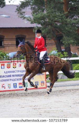 SAINT-PETERSBURG - JULY 07: Rider Natalia Simonia on Gardemarin in Jumping show, stage of the International show jumping event CSI 3*-W/CSIYH1, on July 07, 2012 in Saint-Petersburg, Russia