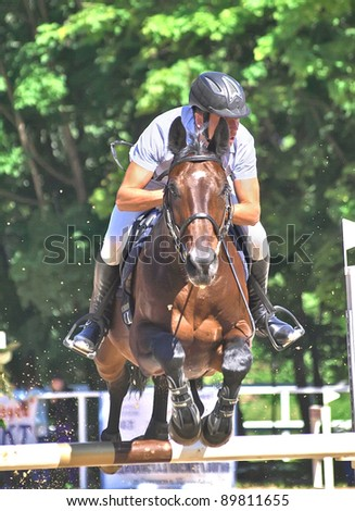 SAINT PETERSBURG-JULY 03: Rider Pavel Vishnyk on Ramshtine in Jumping show, stage of the Open Cup show jumping event on July 03, 2010 in Saint Petersburg, Russia
