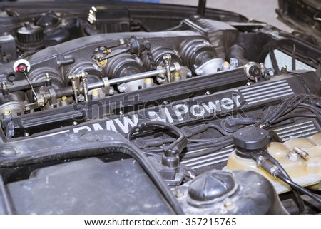 SAINT-PETERSBURG, RUSSIA - APRIL 5, 2014: Engine compartment: motor m-power with attachments, old-car BMW, Bavarian automaker, St. Petersburg, Russia - stock photo