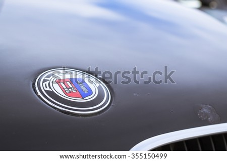 SAINT-PETERSBURG, RUSSIA - APRIL 5, 2014: Logo Alpina. Old-car BMW 5-series e34 at the meeting fans of the Bavarian automaker, St. Petersburg, Russia - stock photo