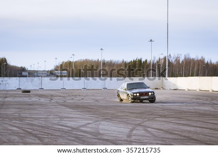 SAINT-PETERSBURG, RUSSIA - APRIL 5, 2014: Old-car BMW 5-series e34 to drift at the meeting fans of the Bavarian automaker, St. Petersburg, Russia - stock photo
