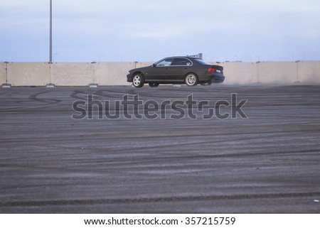 SAINT-PETERSBURG, RUSSIA - APRIL 5, 2014: Old-car BMW 5-series e39 to drift at the meeting fans of the Bavarian automaker, St. Petersburg, Russia - stock photo