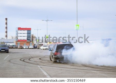 SAINT-PETERSBURG, RUSSIA - APRIL 5, 2014: Old-car BMW 7-series to drift at the meeting fans of the Bavarian automaker, St. Petersburg, Russia - stock photo