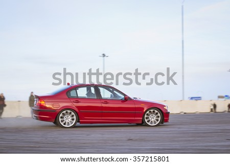 SAINT-PETERSBURG, RUSSIA - APRIL 5, 2014: Red car BMW 3-series to drift at the meeting fans of the Bavarian automaker, St. Petersburg, Russia - stock photo