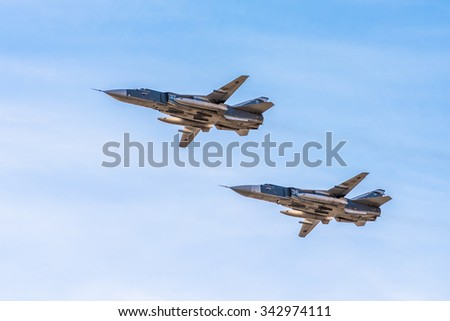 SAINT PETERSBURG, RUSSIA - April, 25, 2015: Sukhoi Su-24 russian supersonic front-line bombers in the sky - stock photo