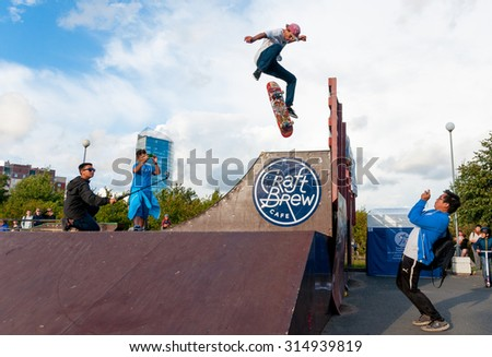 SAINT-PETERSBURG, RUSSIA AUGUST 29 2015: EXTREME FESTIVAL IN THE 300 YEAR PARK, SKATEBOARD RIDERS