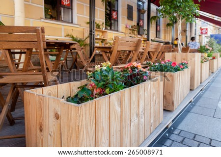 SAINT PETERSBURG, RUSSIA - AUGUST 9, 2014: Traditional summer street cafe near the Church of the Savior on Spilled Blood - stock photo
