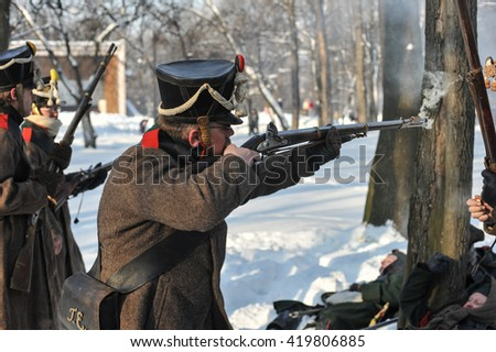 Saint-Petersburg, Russia - February 23, 2016: Reconstruction of the battle Russian grenadiers against  the army of  Napoleon . War of 1812. City park.