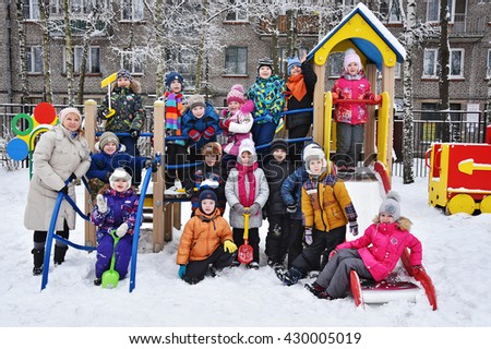 Saint-Petersburg, Russia - January 19, 2016. Russian. Children playing in a kindergarten for a walk in the winter. Graduation group before school. - stock photo