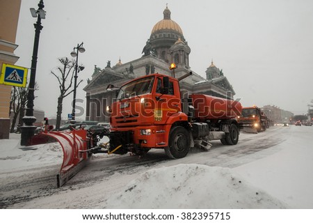 Saint-Petersburg, Russia - January 12, 2016: Snowplows working in the historic tourist center of the city after snowfall