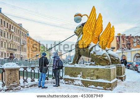 Saint Petersburg, Russia, January 16, 2016. Two young men standing by the Bank bridge at a frosty winter day.