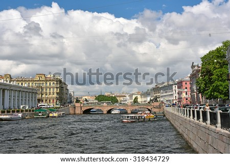 SAINT-PETERSBURG, RUSSIA - JULY 1, 2015: View of Architectural complex of historical buildings of Fontanka River Embankment and oldest famous Anichkov bridge in Saint Petersburg. - stock photo