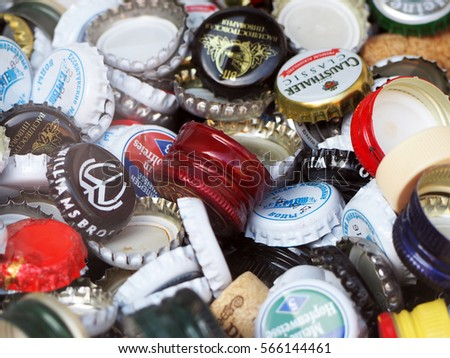 SAINT PETERSBURG, RUSSIA - JUNE, 2016 Background of bottle caps water, wine and beer , a mix of various brands.