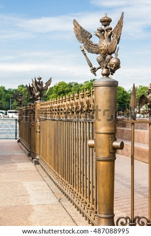 SAINT-PETERSBURG, RUSSIA - JUNE 22, 2016: Cast-iron railing with double-headed eagles around the Alexander Column on Palace Square in St. Petersburg