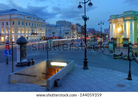 """SAINT PETERSBURG, RUSSIA - JUNE 16: Midnight along the Nevsky street at Gostiny Dvor in Saint Petersburg, Russia on June 16, 2013, during the so called """"white nights"""" days of June. - stock photo"""