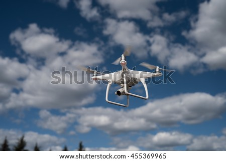 Saint-Petersburg, Russia - June 4, 2016: The Phantom quadrocopters flying on a background of clouds and blue sky during a shooting location. - stock photo