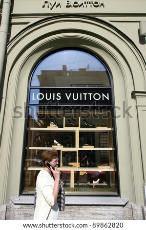 SAINT PETERSBURG, RUSSIA - JUNE 15: Upscale shoppers walk by a Louis Vuitton store in Saint Petersburg, Russia on Wednesday, June 15, 2011 - stock photo