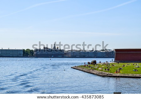 Saint-Petersburg, Russia - 01 June, 2016: Wild beach near Peter and Paul fortress in St. Petersburg, Russia on 01 June, 2016.