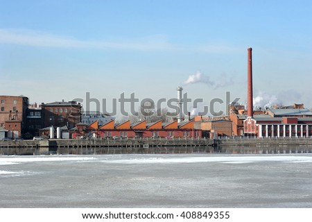 "Saint-Petersburg, Russia - March 21, 2016: The plant of a company producing cosmetics ""Neva cosmetics"" on the embankment of the river Neva in St. Petersburg"