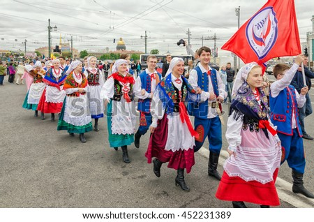 "Saint Petersburg, Russia, May 28, 2016. ""Ball of Nationalities"" festival participants the Polish folk dance ensemble ""GAIK"" are passing to the point of the performance"