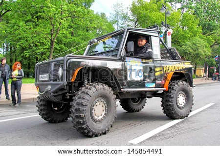 SAINT PETERSBURG, RUSSIA - MAY 25: Fedor Toschev's off-road vehicle Land Rover Defenfer 90 No.716 competes at the annual Ladoga Trophy Challenge on May 25, 2013 in Saint Petersburg, Russia. - stock photo