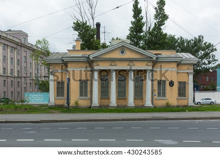 "SAINT-PETERSBURG, RUSSIA  ?? MAY 25, 2016:Trolleybus station ""Marina"". House in the style of Stalin classicism, 1954. Saint-Petersburg, Russia."