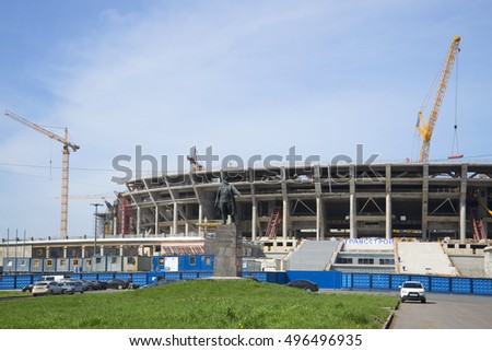 SAINT PETERSBURG, RUSSIA - MAY 18, 2014: view of the monument to S. M. Kirov on the background of the football stadium construction on Krestovsky island