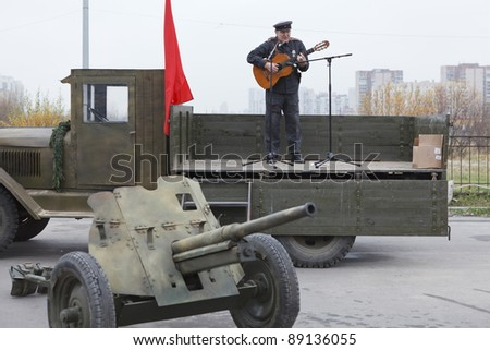 SAINT-PETERSBURG, RUSSIA – NOVEMBER 4: Military performance in celebration of National Unity Day. Soviet soldier singing from the lorry on November 4, 2011 in Saint-Petersburg, Russia.