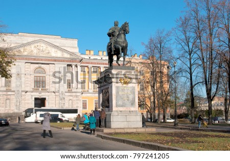 SAINT-PETERSBURG, RUSSIA - NOVEMBER 2, 2017: People look and take pictures near the Monument to Peter The Great. On the background is Saint Michael Castle (Mikhailovsky)