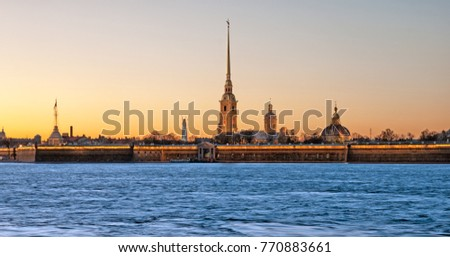 SAINT - PETERSBURG, RUSSIA - NOVEMBER 1, 2017: The Peter and Paul Fortress with night illumination. On the background is constructing of Lakhta Center (Gazprom City) skyscraper