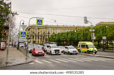 Saint Petersburg, Russia - Oct 14, 2016. Cars stopping on street at downtown in Saint Petersburg, Russia