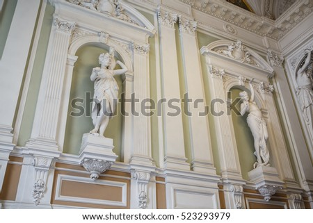 Saint Petersburg, Russia, October 18, 2016: historical marble sculptures of Greek goddesses at the Wedding Palace on English Embankment in St. Petersburg. Ancient sculptures in the interior.