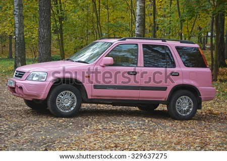 SAINT-PETERSBURG, RUSSIA- OCTOBER 20: Old style pink Honda car in Saint-Petersburg city, Russia on October 20, 2015