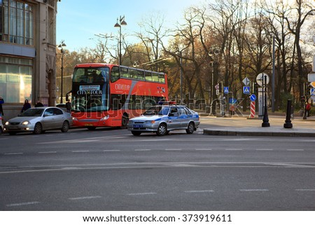 Saint-Petersburg, Russia - October 27, 2012: Tourist bus and police car on a background of the Alexander Garden