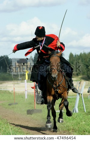 SAINT-PETERSBURG, RUSSIA - SEPT 12: Yury Efremov in action during the Championship of Saint-Petersburg on military-applied types of equestrian sport on Sep 12, 2009 in Saint-Petersburg, Russia.