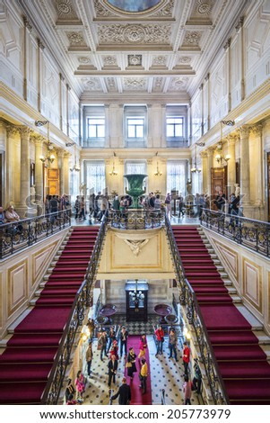 SAINT PETERSBURG, RUSSIA - SEPTEMBER 8, 2013: Visitors tour the Hermitage Museum. Founded in 1764, it is one of the oldest museums in the world. - stock photo