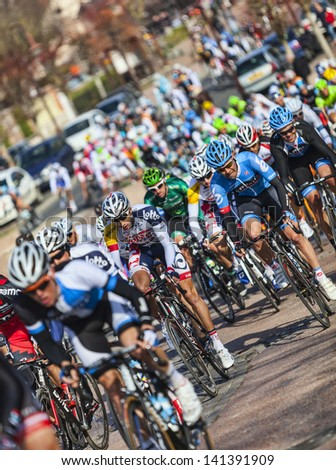 SAINT-PIERRE-LES-NEMOURS,FRANCE,MARCH 4: I Image of the peloton riding fastly, during the first stage of the famous road bicycle race Paris-Nice, on March 4, 2013 in  Saint-Pierre-les-Nemours.