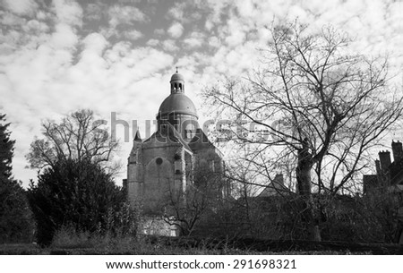 Saint-Quiriace Collegiate church in medieval town of Provins (Ile-de-France, France). Medieval town of Provins is UNESCO World Heritage Site. Aged photo. Black and white. - stock photo