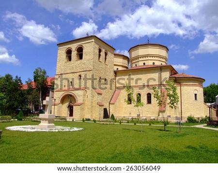 Saint Sava Church Iasi with white cross and blue sky behind - stock photo