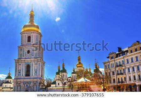 Saint Sophia Sofia Cathedral Spires Towe Golden Dome Under Sun Sofiyskaya Square Kiev Ukraine.  Oldest Cathedral and Church in Kiev.  Saint Sofia was built by King Yaroslov the Wise in 1037. - stock photo