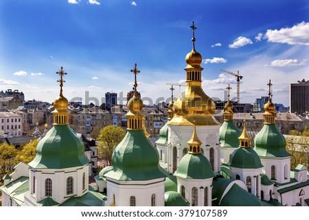 Saint Sophia Sofia Cathedral Spires Tower Golden Dome Sofiyskaya Square Kiev Ukraine.  Saint Sophia is oldest Cathedral and Church in Kiev.  Saint Sofia was built by King Yaroslov the Wise in 1037. - stock photo