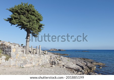 Saint Stefan ancient basilica and beach at Kos island in Greece - stock photo
